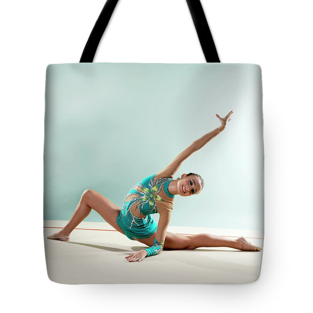 Human Arm Tote Bag featuring the photograph Gymnast, Smiling, Bending Backwards by Emma Innocenti