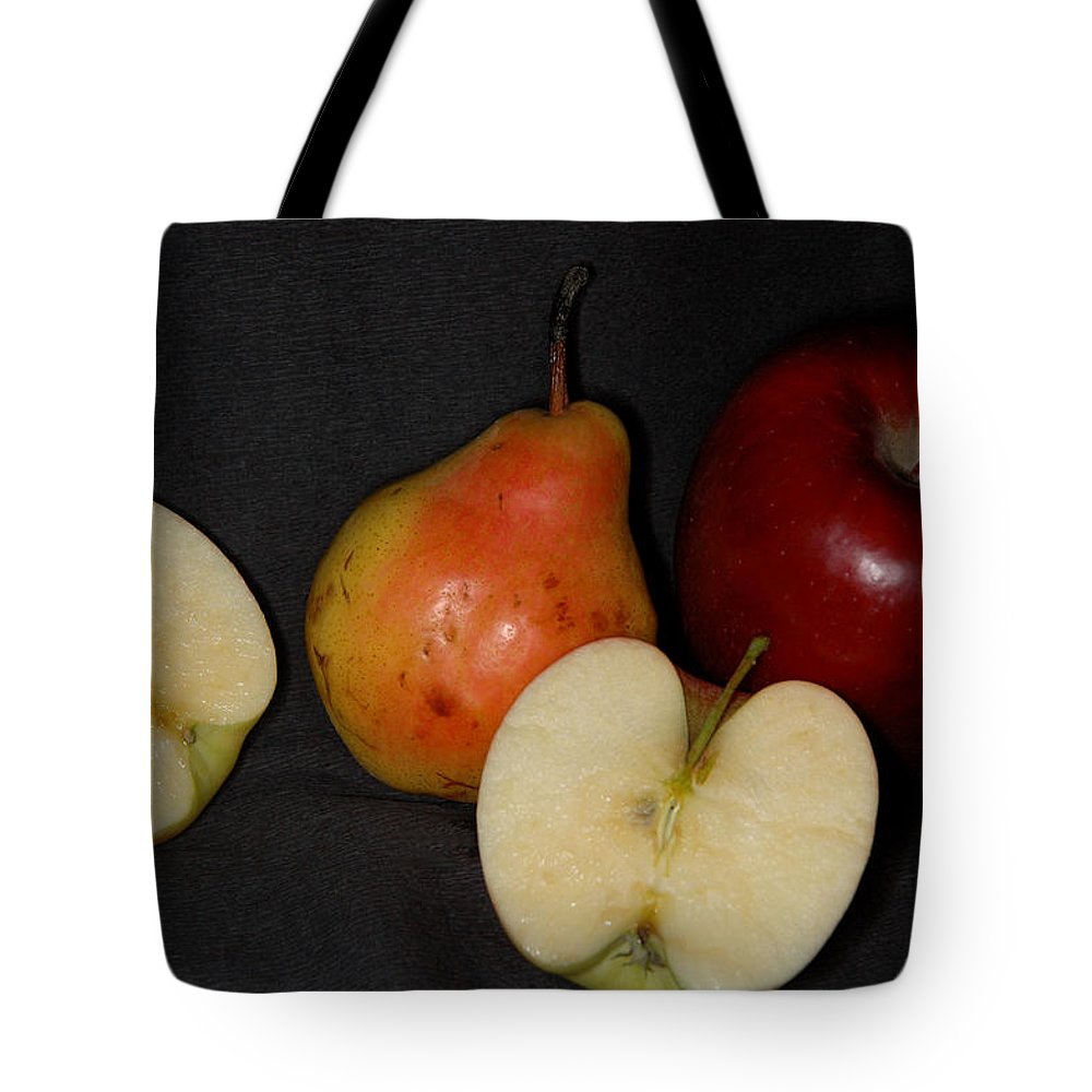 Apple Tote Bag featuring the photograph Half An Apple On Black by Guido Strambio