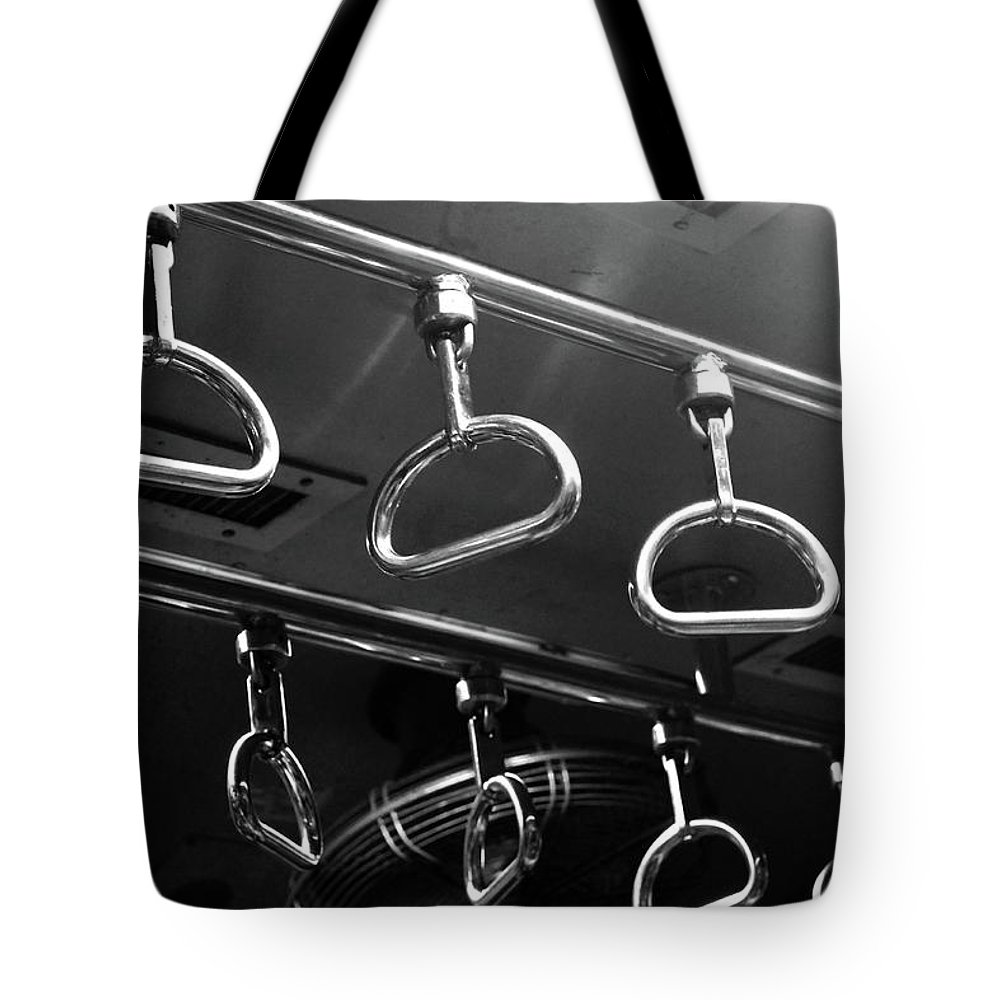 Handle Tote Bag featuring the photograph Handles Inside Mumbai Local Train by Riteshsaini