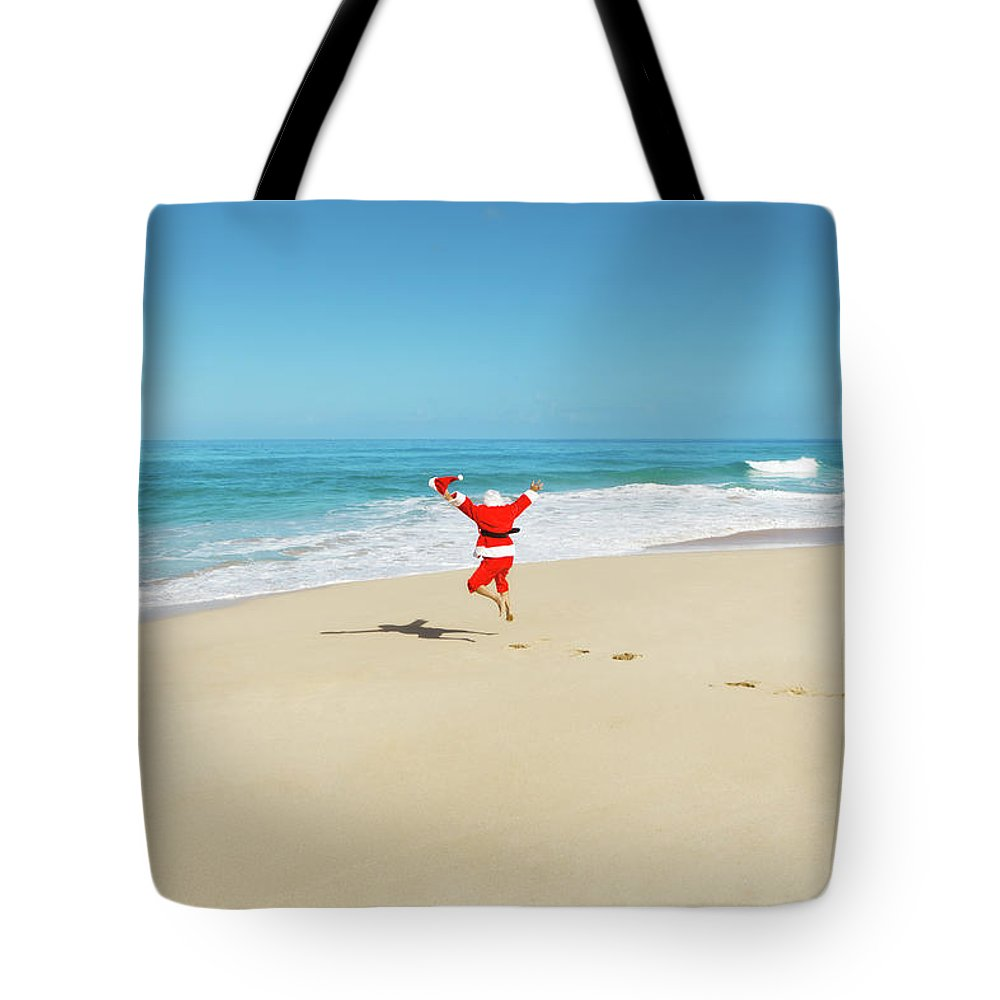 Scenics Tote Bag featuring the photograph Happy Excited Jumping Santa Claus On by Yinyang