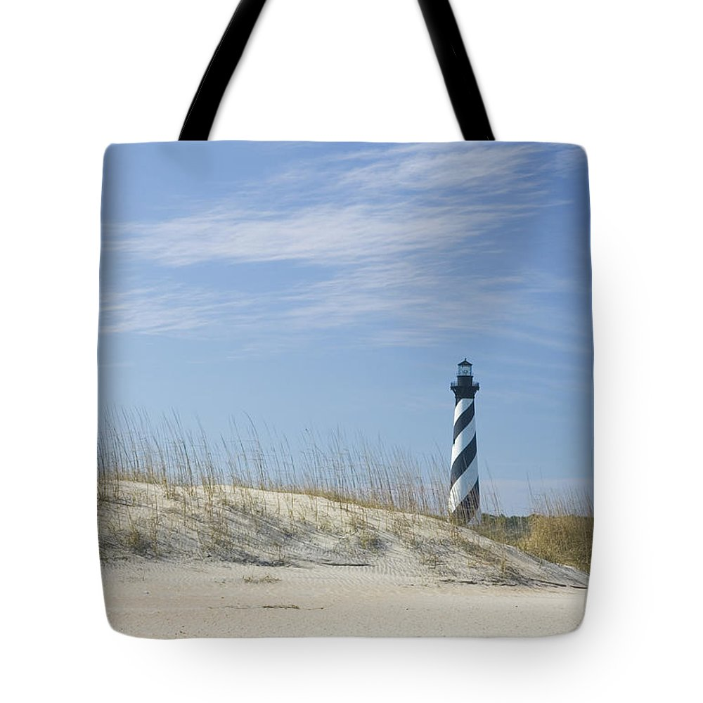 North Carolina Tote Bag featuring the photograph Hatteras Lighthouse And The Dunes by Myhrcat