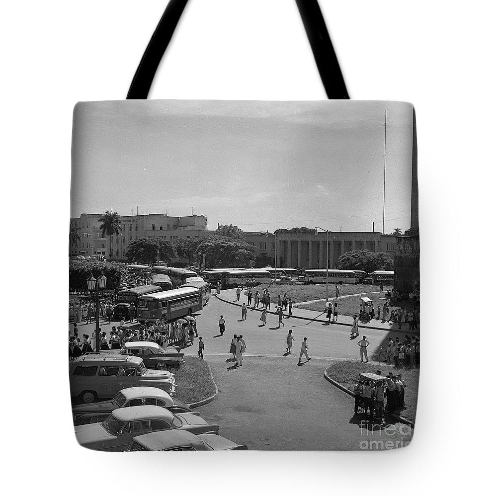 Bus Tote Bag featuring the photograph Havana Bus Park by Venancio Diaz