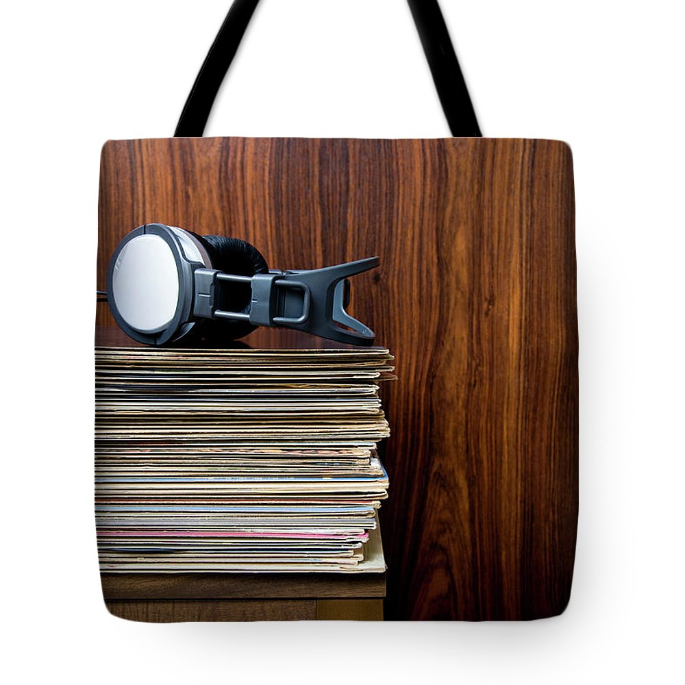 Technology Tote Bag featuring the photograph Headphones Laying On Stack Of Vinyl by Steven Errico