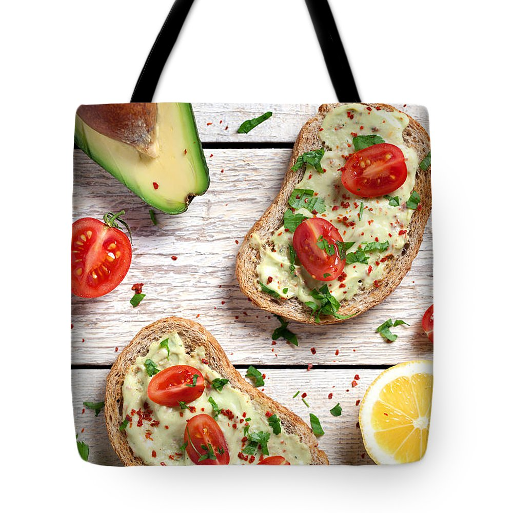 Breakfast Tote Bag featuring the photograph Healthy Whole Grain Bread With Avocado by Barcin