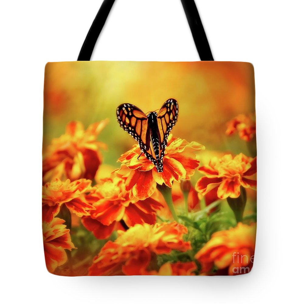 Butterfly Tote Bag featuring the photograph Heart of the Marigolds by Heather Hubbard