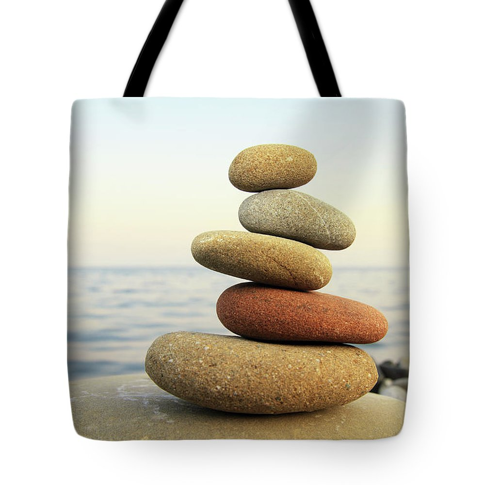 Recreational Pursuit Tote Bag featuring the photograph Hierarchy And Balance by Petekarici