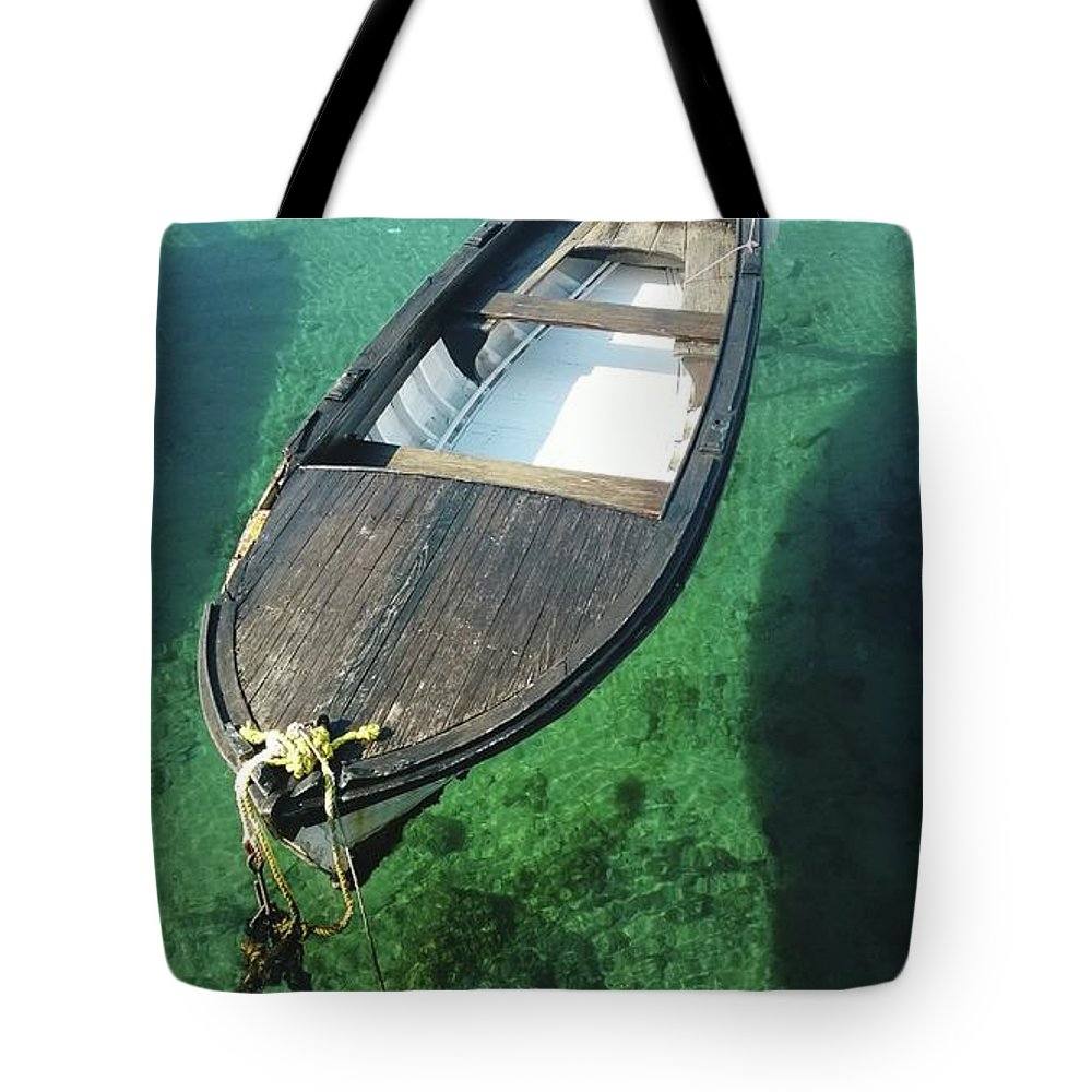 Tranquility Tote Bag featuring the photograph High Angle View Of Boat Moored On Sea by Iva Saric / Eyeem