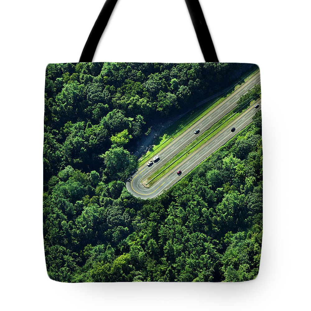 The End Tote Bag featuring the photograph Highway U-turn In Forest by Thomas Jackson