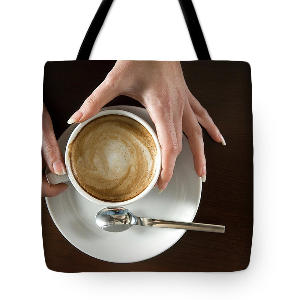 Spoon Tote Bag featuring the photograph Holding Cappuccino by 1001nights