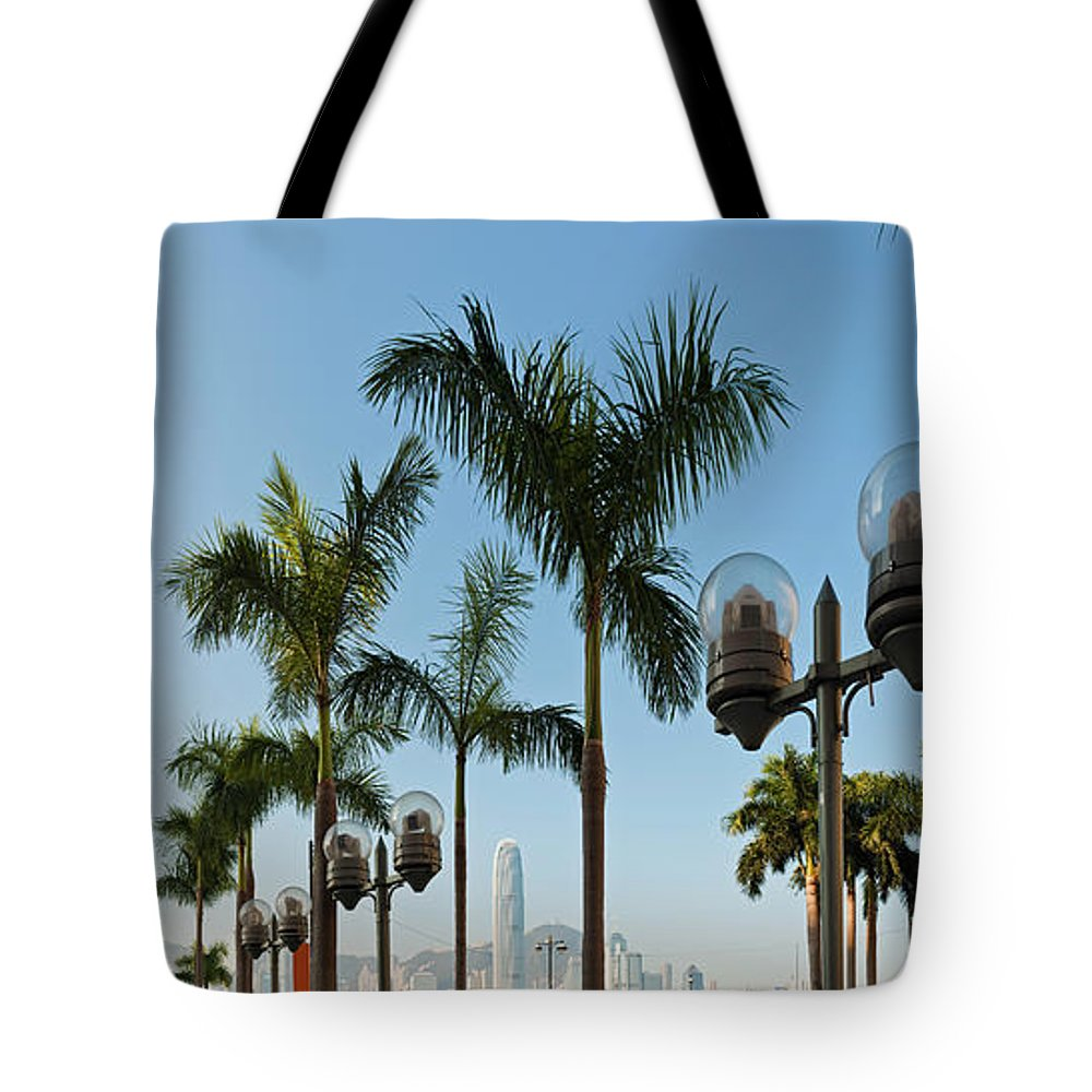 Chinese Culture Tote Bag featuring the photograph Hong Kong Clock Tower Ferry Terminal by Fotovoyager