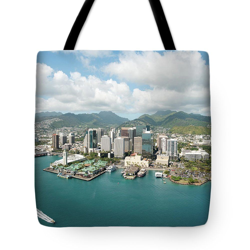 Honolulu Tote Bag featuring the photograph Honolulu Skyline Shot From A Helicopter by 400tmax