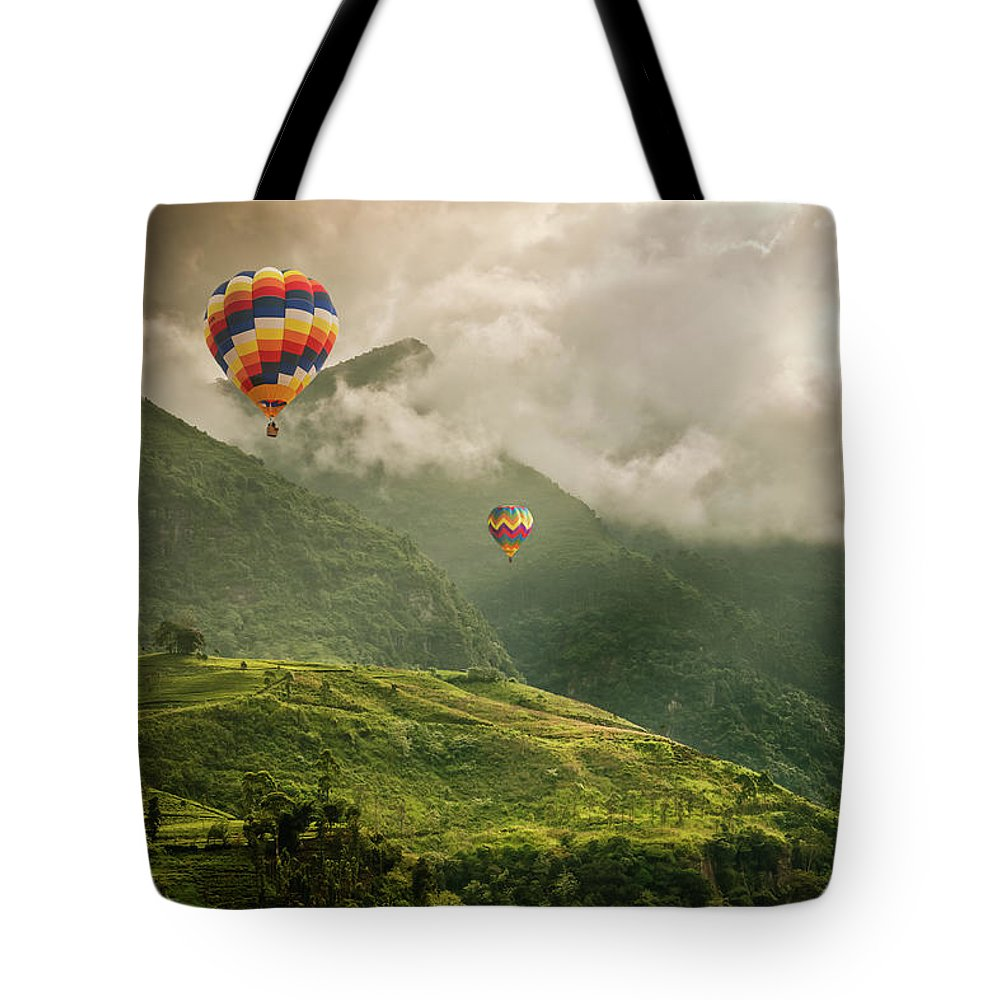 Tranquility Tote Bag featuring the photograph Hot Air Balloons Over Tea Plantations by Nicolo Sertorio