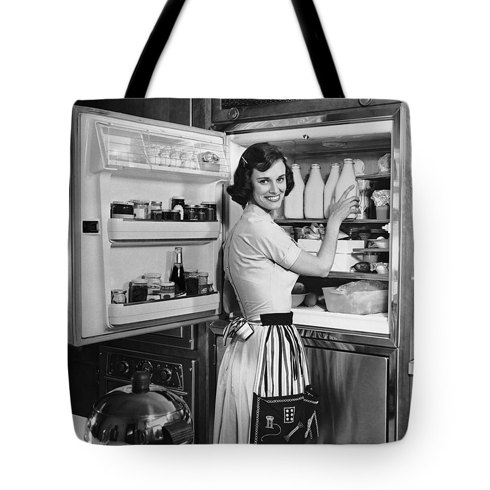 Milk Tote Bag featuring the photograph House Wife Removing Milk From by George Marks