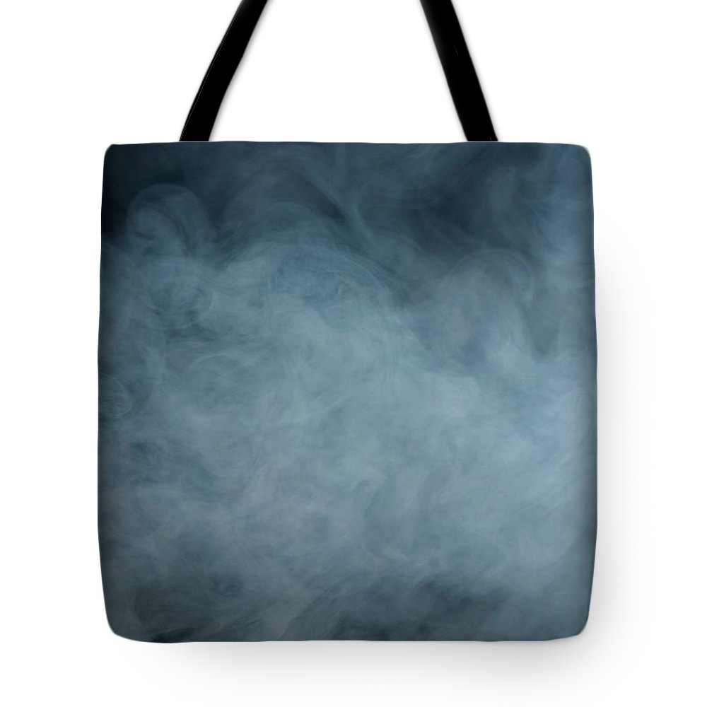 Air Pollution Tote Bag featuring the photograph Huge White Cloud Of Smoke In A Dark Room by Lastsax