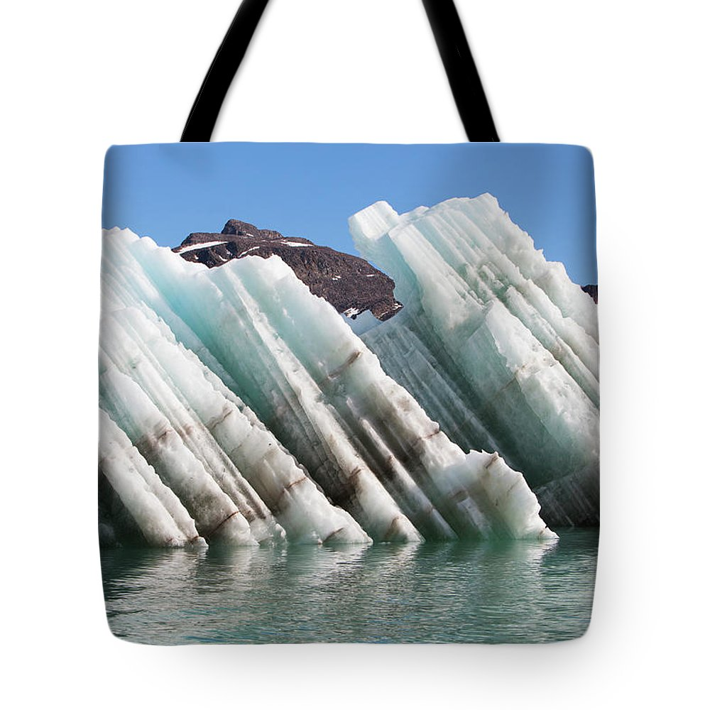 Iceberg Tote Bag featuring the photograph Iceberg Streaked With Rock Debris by Anna Henly