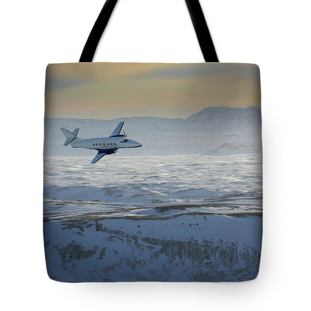 Scenics Tote Bag featuring the photograph Iceland, Cessna Plane Flying Over Snow by Arctic-images