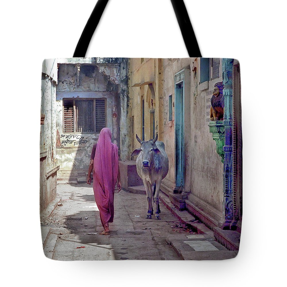 Horned Tote Bag featuring the photograph India Lady And Cow by Glenn Losack