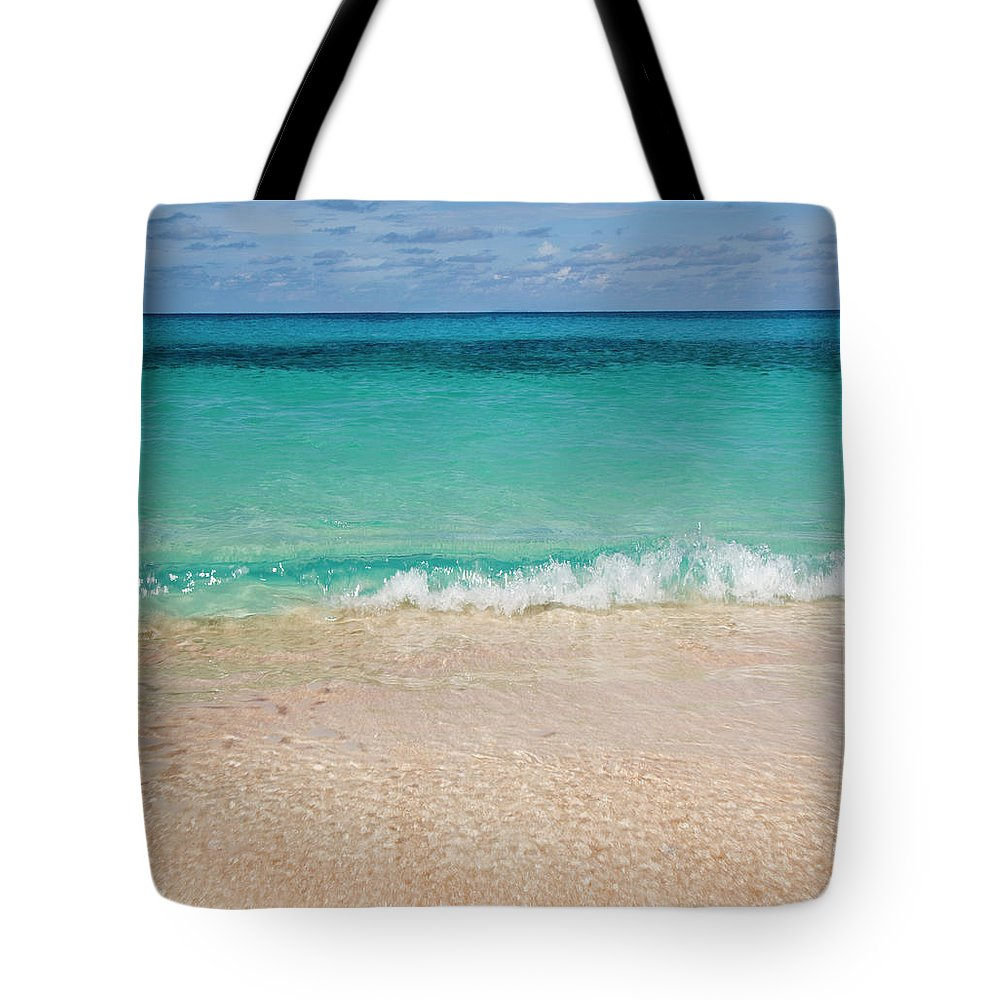 Water's Edge Tote Bag featuring the photograph Indonesia, Waves Rolling In From Indian by Joe Mcbride