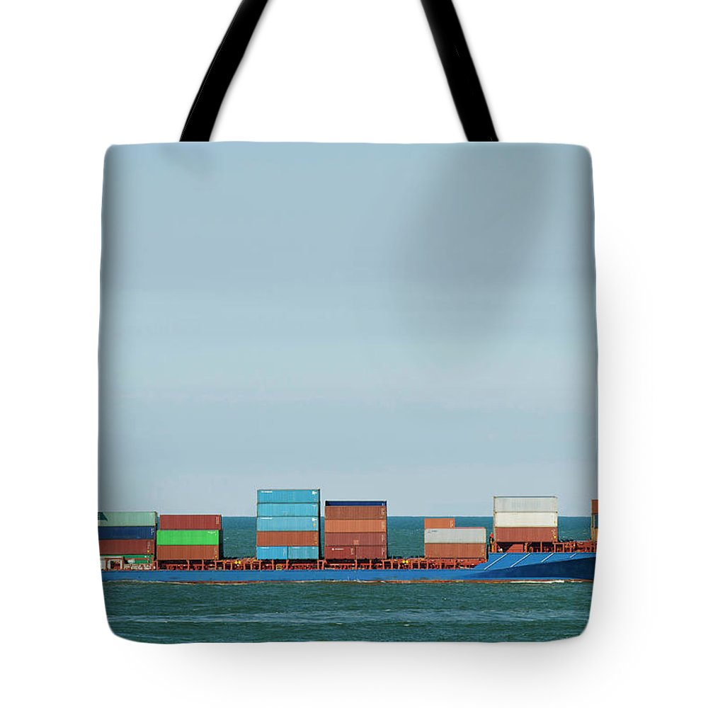 Freight Transportation Tote Bag featuring the photograph Industrial Barge Carrying Containers by Mischa Keijser