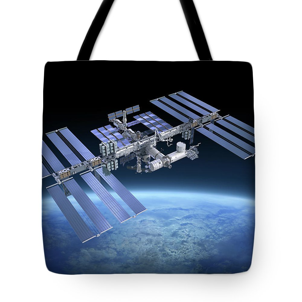 Solar Power Station Tote Bag featuring the photograph International Space Station Iss by Scibak