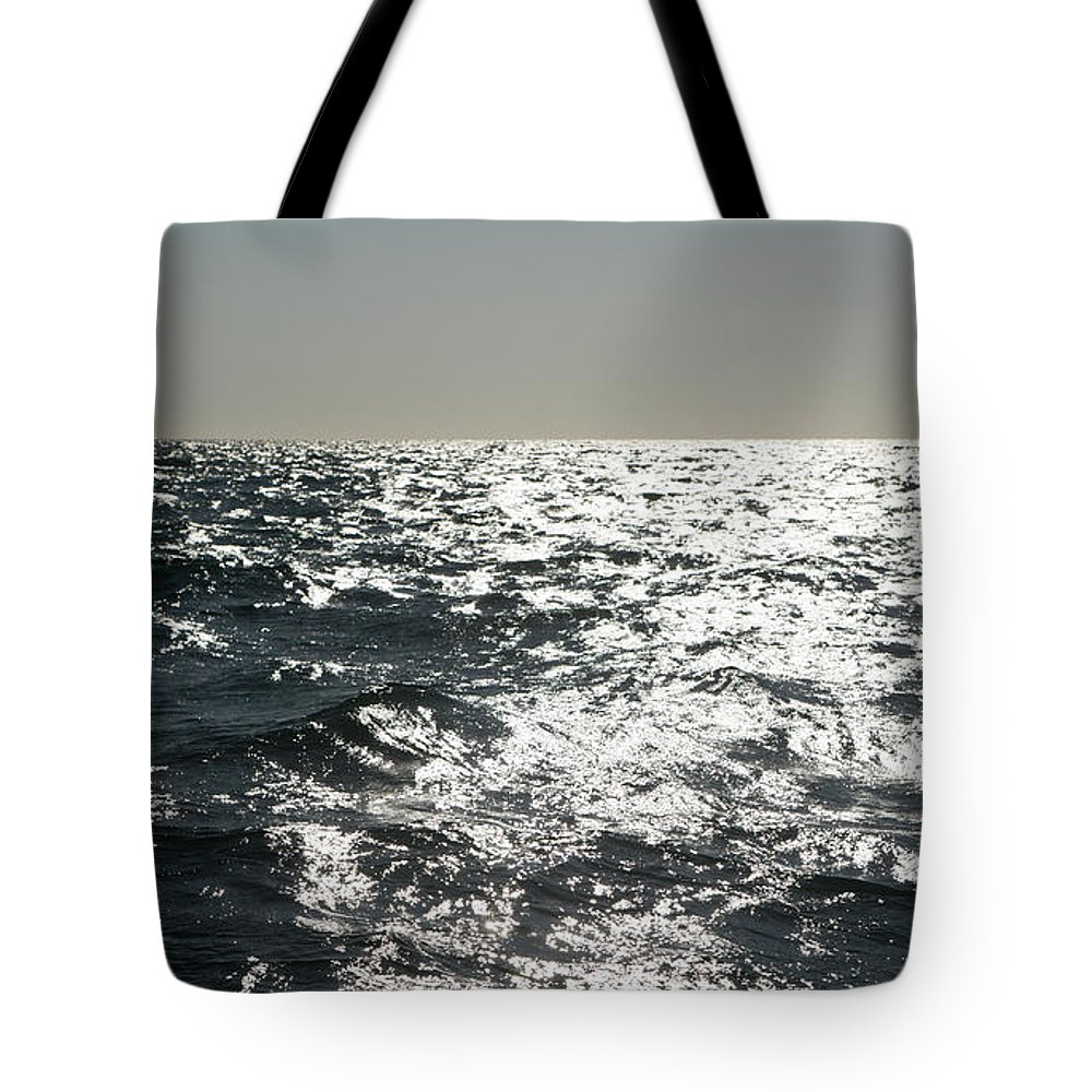 East Tote Bag featuring the photograph Into The Night by Digiclicks