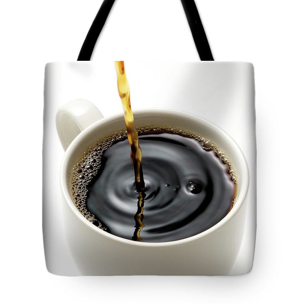 Breakfast Tote Bag featuring the photograph Isolated Shot Of Pouring A Fresh Coffee by Kyoshino