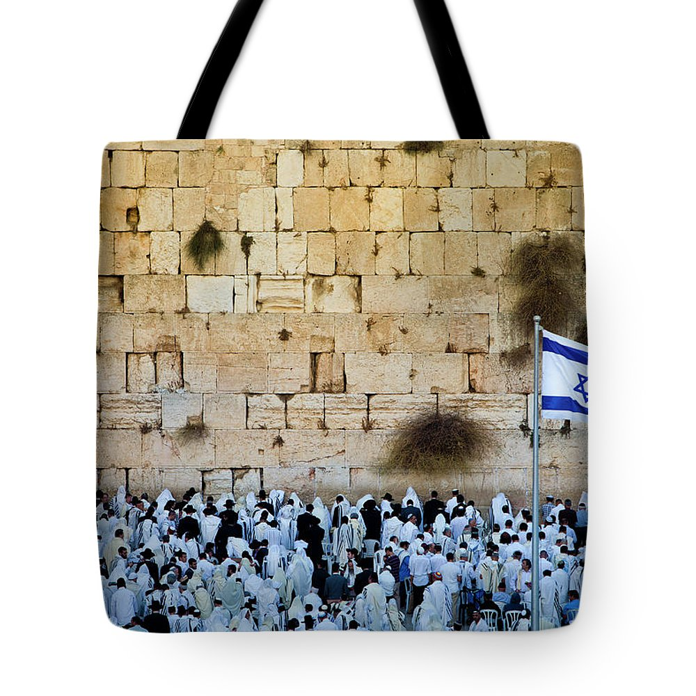 Crowd Tote Bag featuring the photograph Israeli Flag Flies At The Western Wall by Gary S Chapman