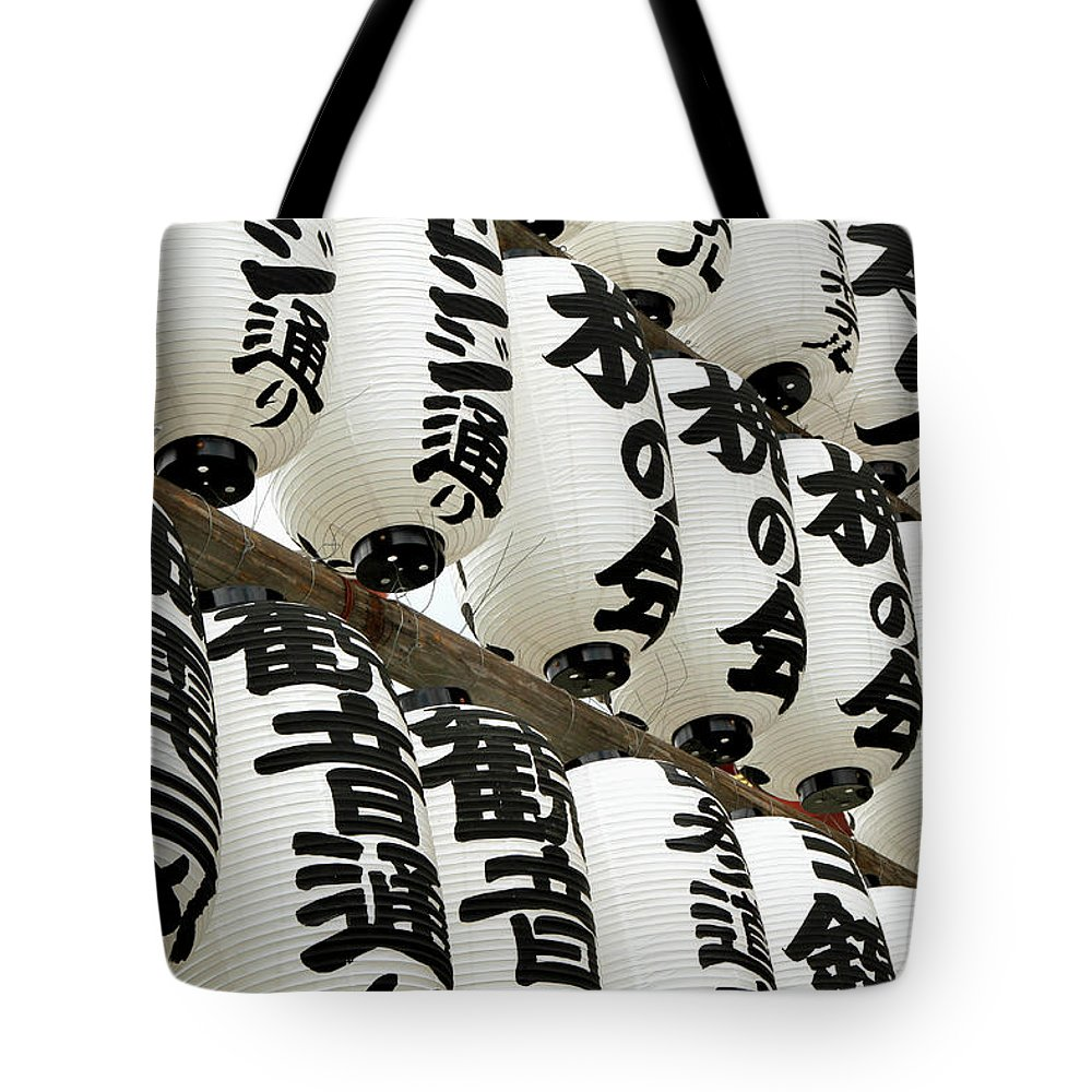Pole Tote Bag featuring the photograph Japanese Paper Lanterns In Preparation by Britta Wendland