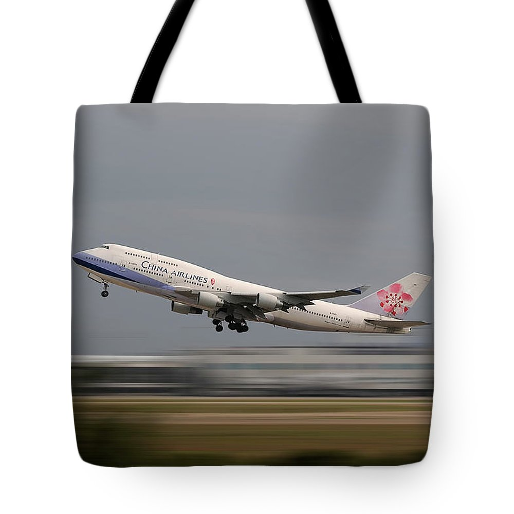Taoyuan Airport Tote Bag featuring the photograph Jumbo by Dr Frikkie Bekker