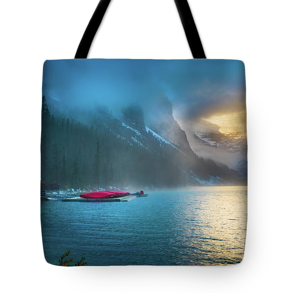 Alberta Tote Bag featuring the photograph Lake Louise Canoes In The Morning by Inge Johnsson