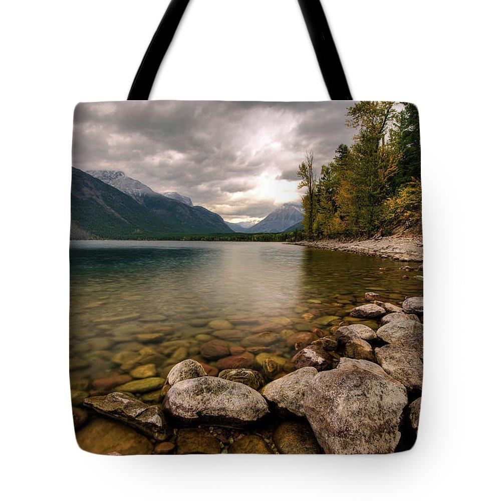 Water's Edge Tote Bag featuring the photograph Lake Mcdonald by Mason Cummings