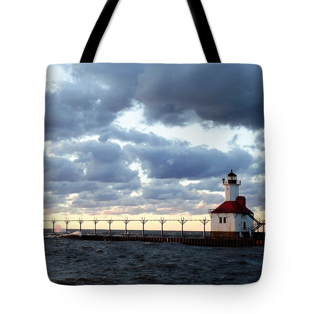 Water Tote Bag featuring the photograph Lake Michigan Lighthouse by Katherine Taibl