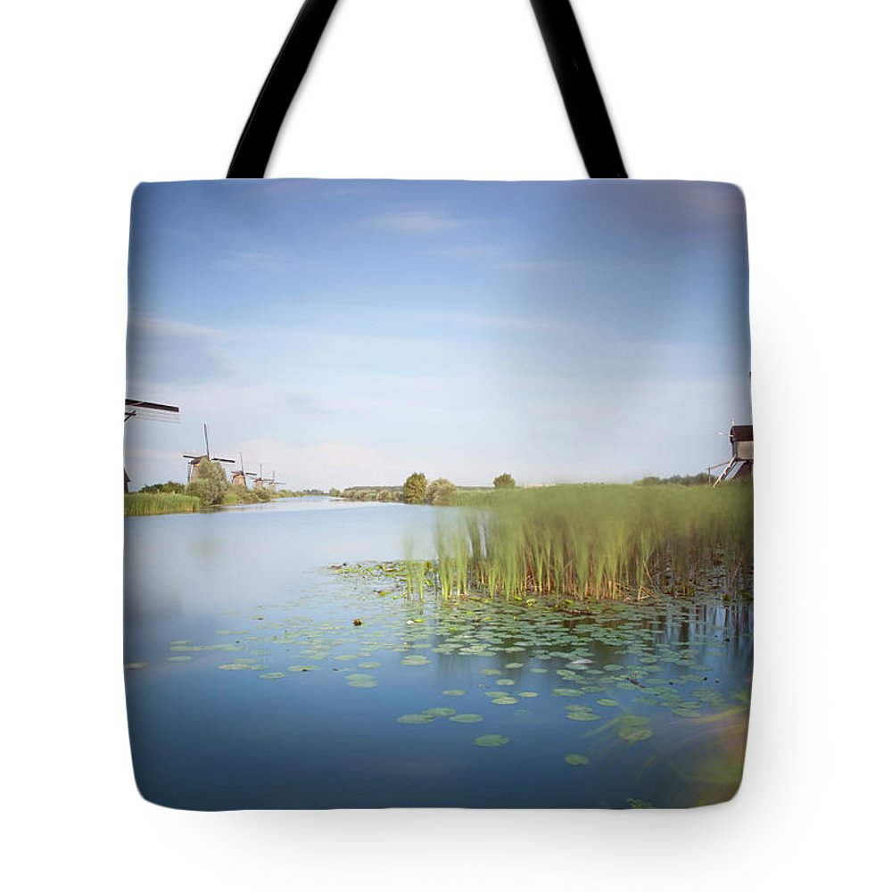 Tranquility Tote Bag featuring the photograph Landscape With Windmills, Kinderdijk by Frank De Luyck