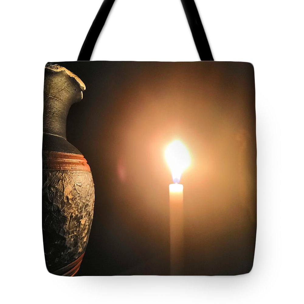 Candle Light Tote Bag featuring the photograph Light In The Dark by Ian Batanda