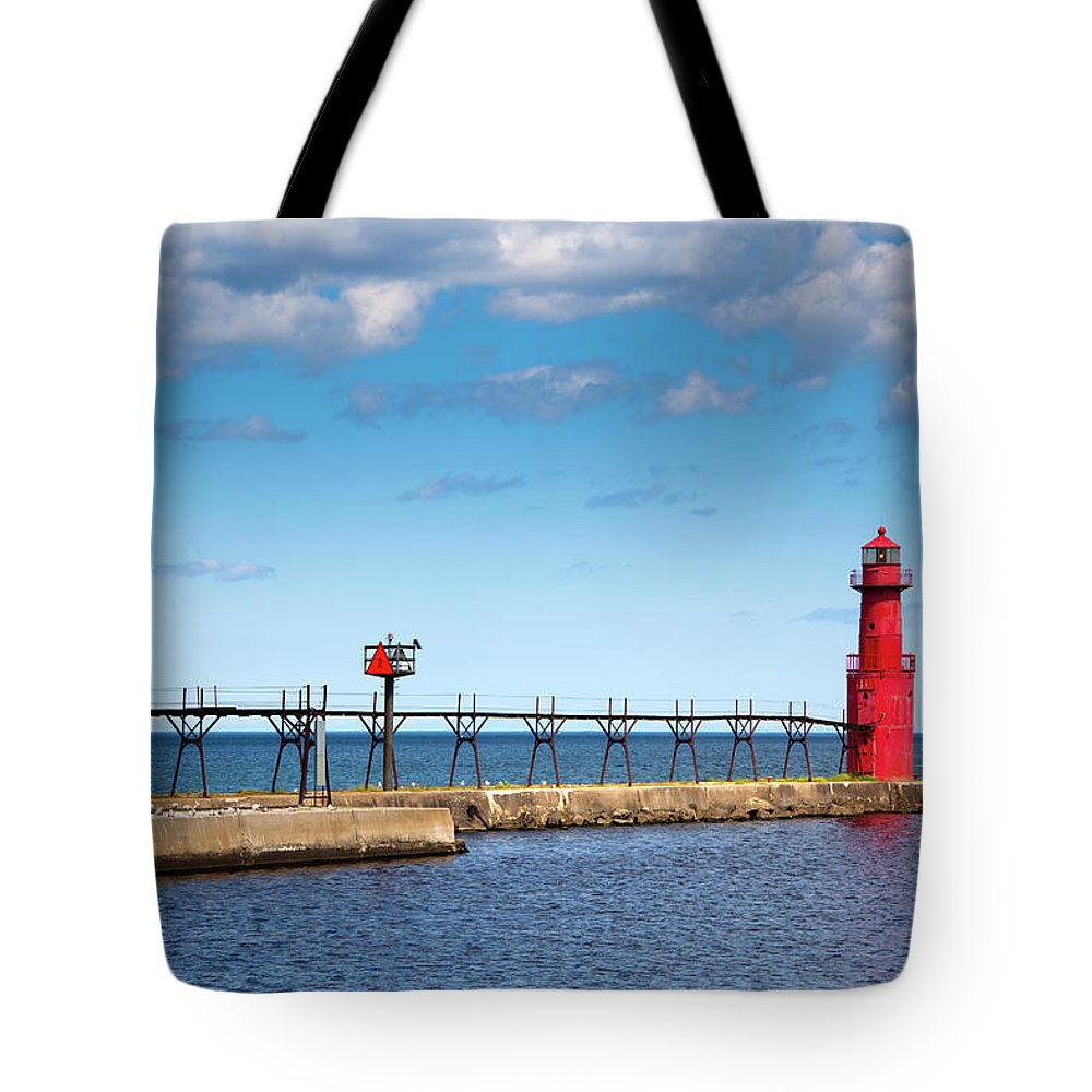 Lake Michigan Tote Bag featuring the photograph Lighthouse And Pier On Lake Michigan by Jamesbrey