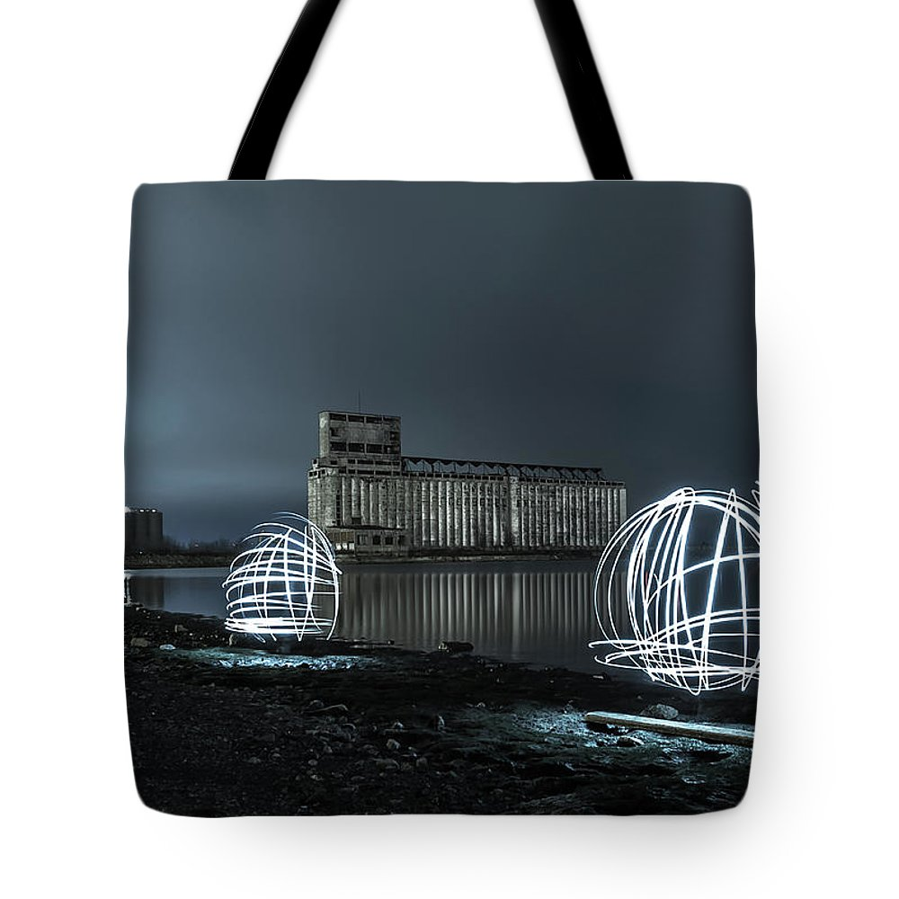 Galagher Pier Tote Bag featuring the photograph Lights in the Night by Dave Niedbala