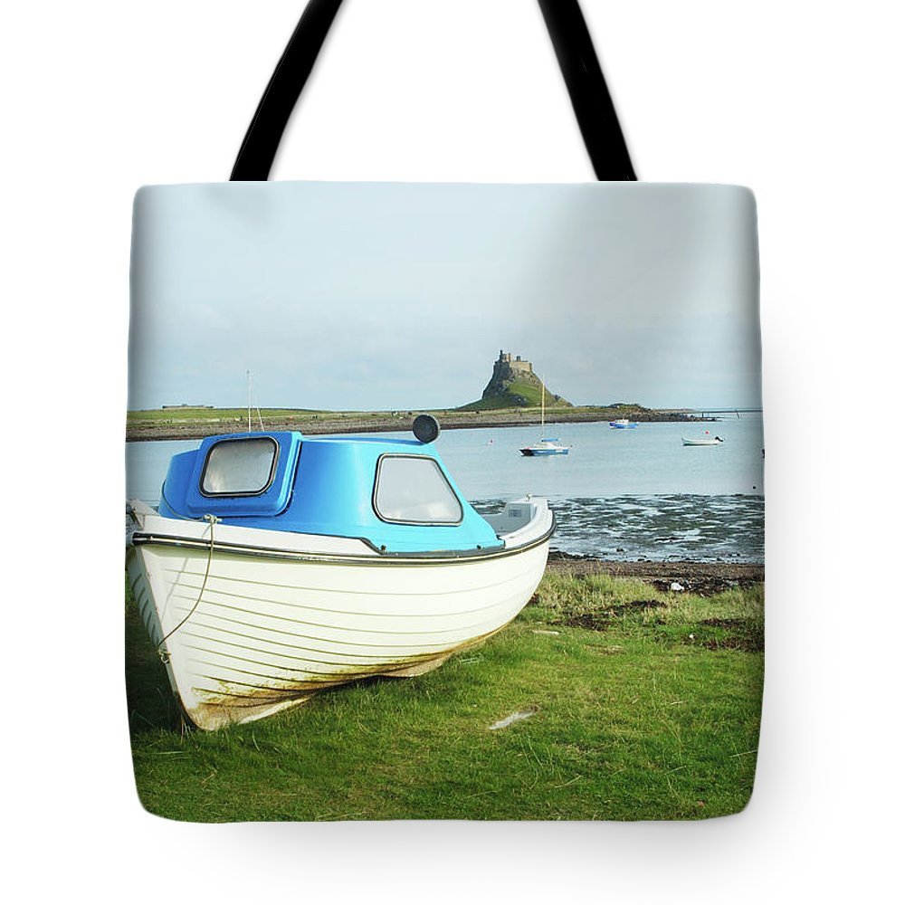 Lindisfarne Tote Bag featuring the photograph Lindisfarne Castle, Bay And Boat by Victor Lord Denovan