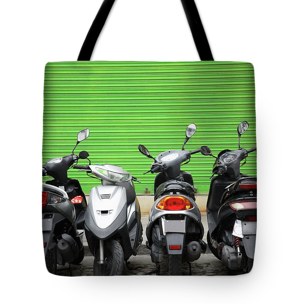 Macao Tote Bag featuring the photograph Line Of Motorbikes Against Green by Steven Puetzer