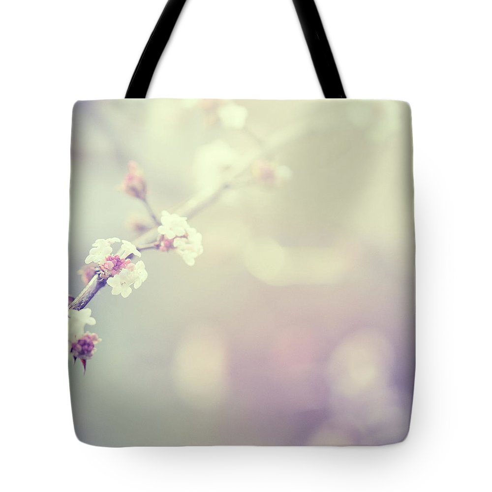 Silence Tote Bag featuring the photograph Little Flowers In Winter by Rike