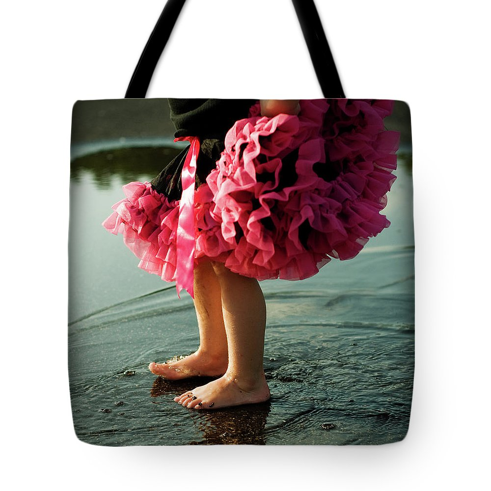 Toddler Tote Bag featuring the photograph Little Girls Feet Splashing And Dancing by Ssj414