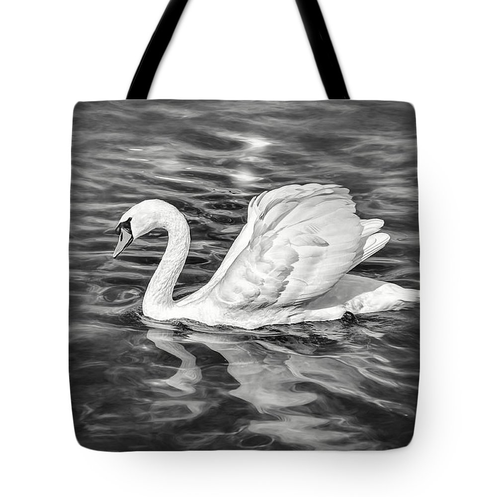 Swan Tote Bag featuring the photograph Lone Swan Lake Geneva Switzerland In Black And White by Carol Japp