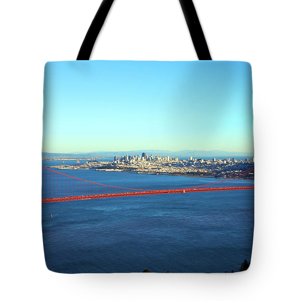 Downtown District Tote Bag featuring the photograph Looking Down At The San Francisco Bridge by Ekash