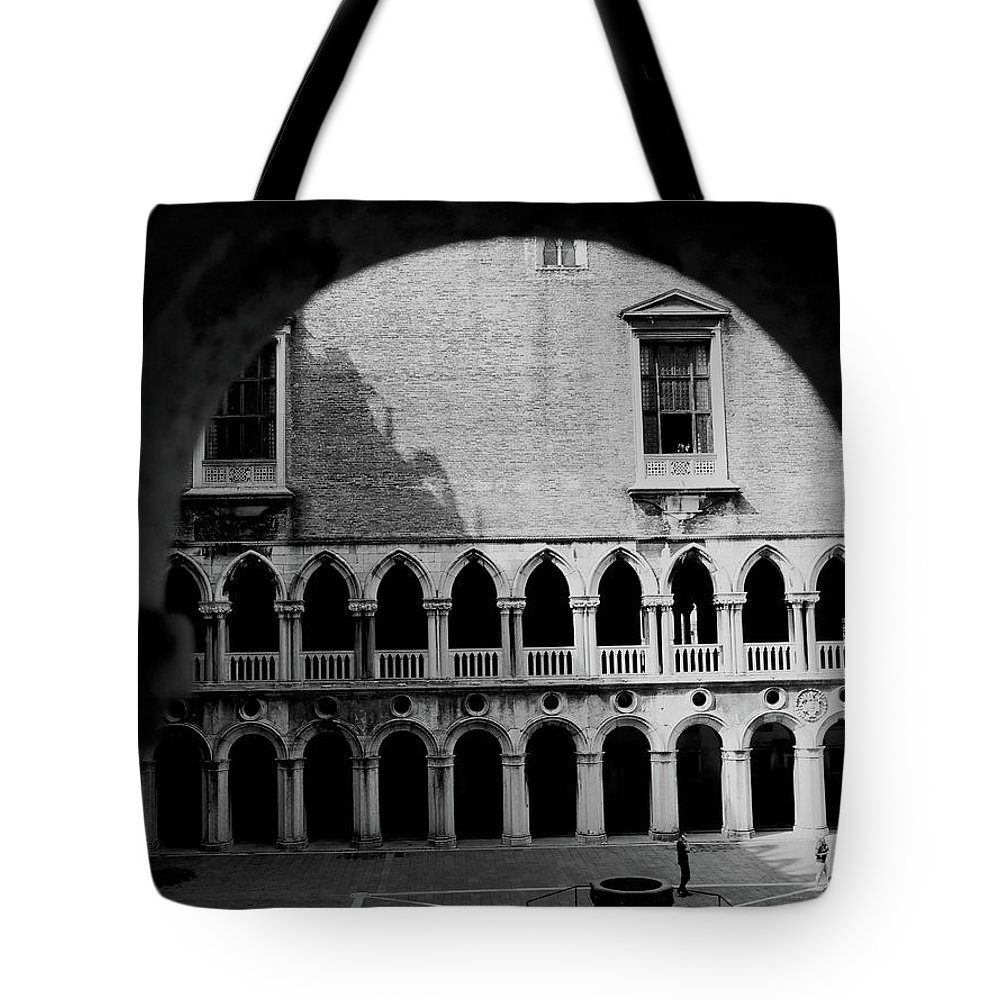 Arches Tote Bag featuring the photograph Looking Out by Romaisa Hashmi