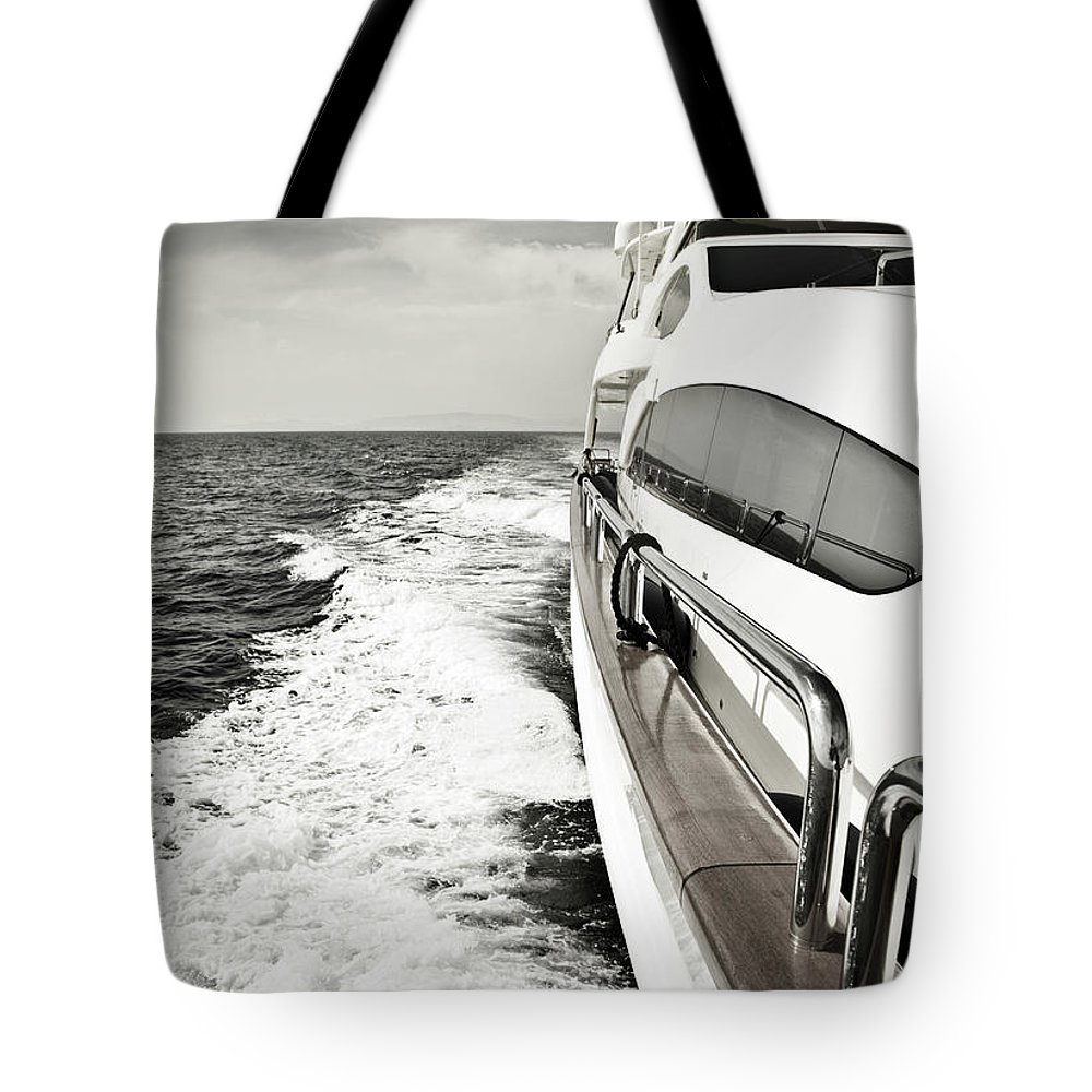 Desaturated Tote Bag featuring the photograph Luxury Yacht Sailing At High Speed In by Petreplesea
