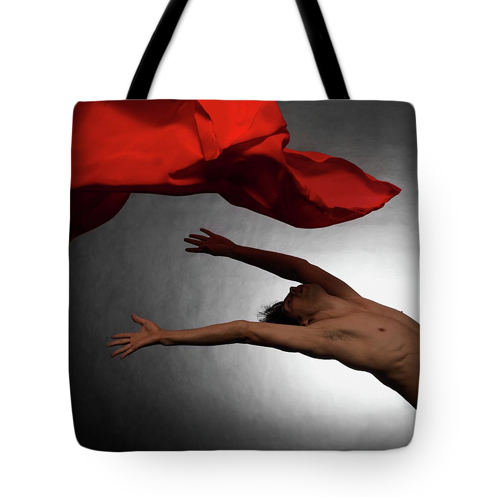 Ballet Dancer Tote Bag featuring the photograph Male Ballet Dancer Dancing With A Red by Win-initiative/neleman