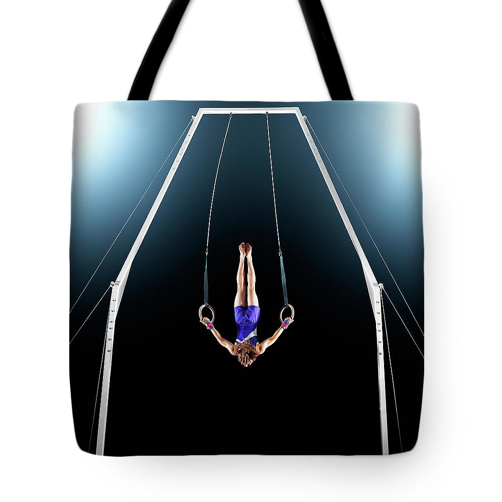 Focus Tote Bag featuring the photograph Male Gymnast Upside Down Performing On by Robert Decelis Ltd