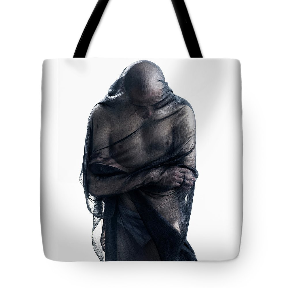 Three Quarter Length Tote Bag featuring the photograph Man Covered In Black Material by Tara Moore