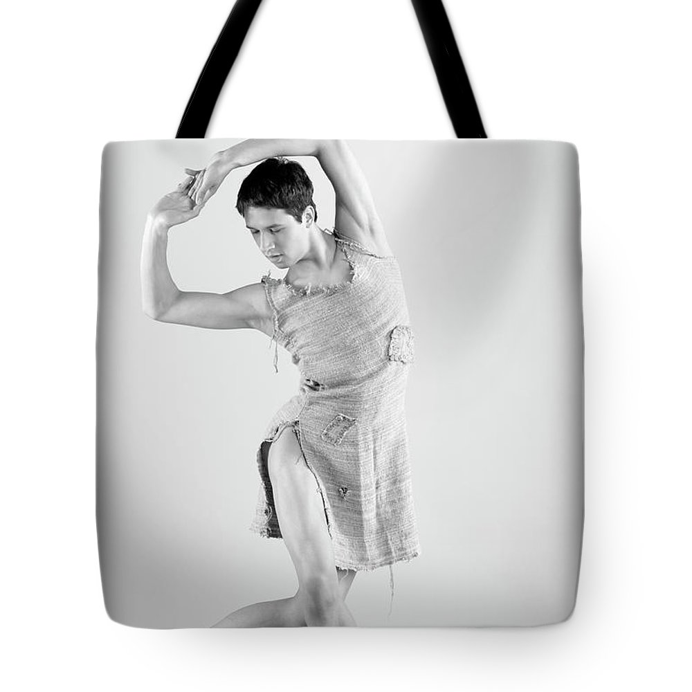 Ballet Dancer Tote Bag featuring the photograph Man Dance by Oleg66