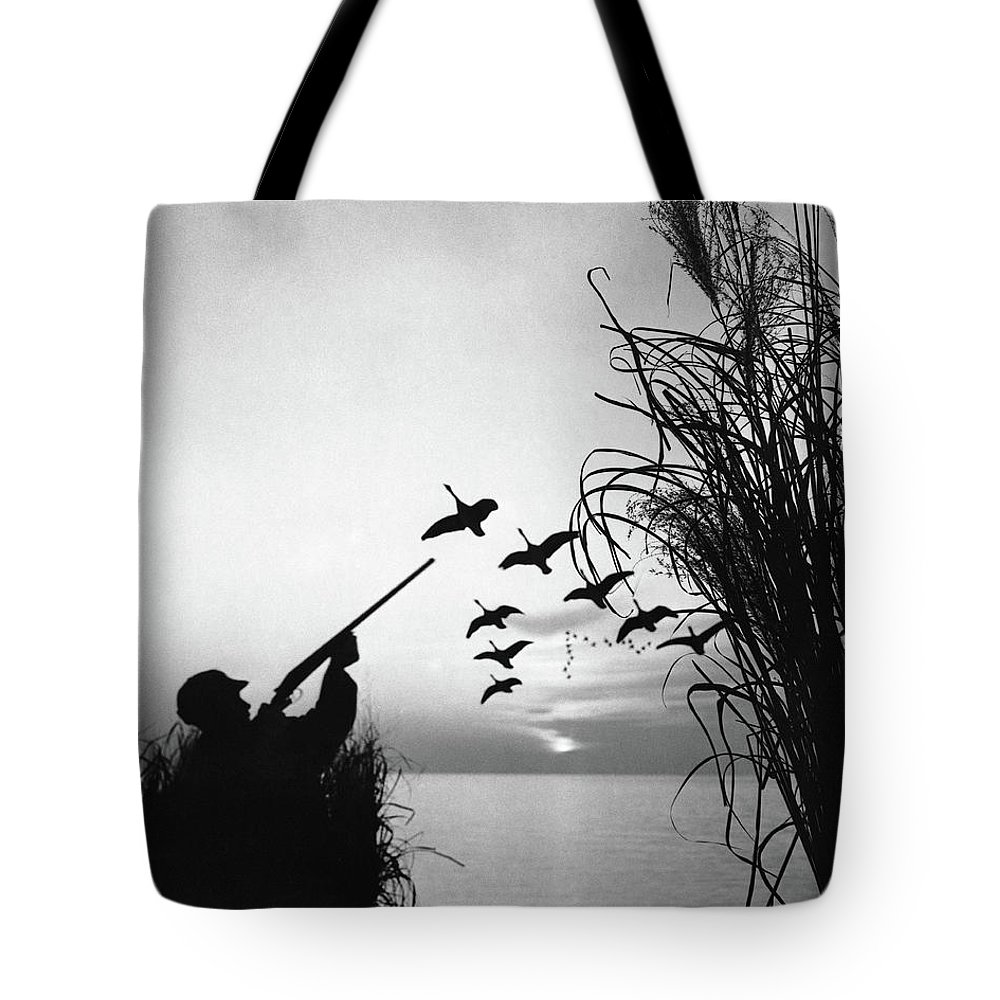 Rifle Tote Bag featuring the photograph Man Duck-hunting by Stockbyte