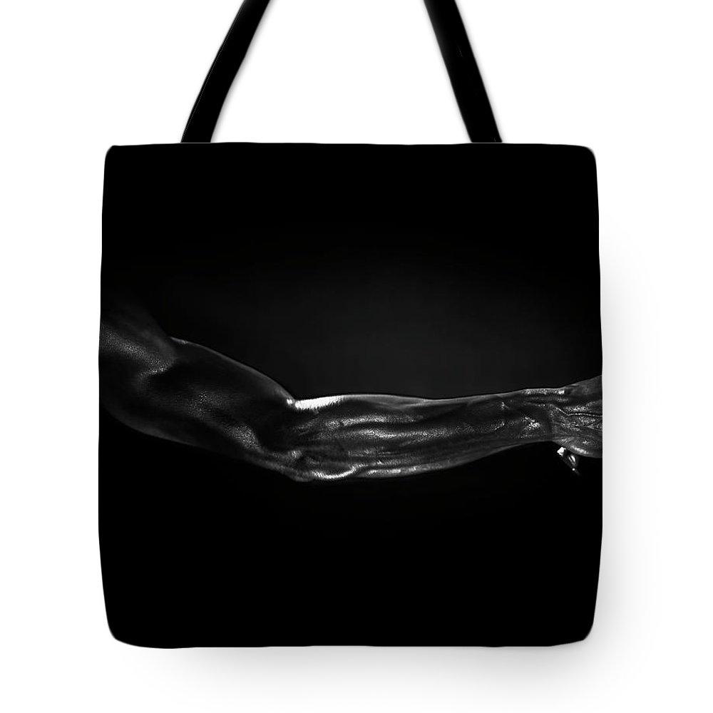Human Arm Tote Bag featuring the photograph Man Holding Tennis Racket, B&w Digital by Hans Neleman